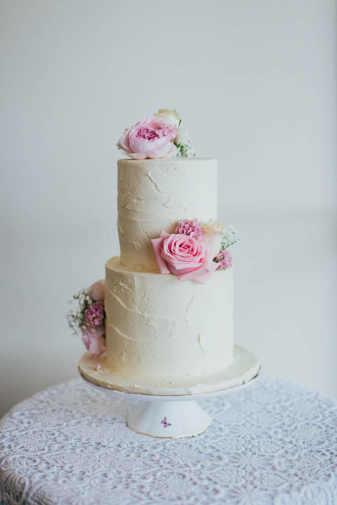 Buttercream cake with groupings of florals