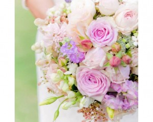 Hand held bouquet including Lullaby roses, stock, sweet pea, snap dragons, berries, lisianthus, stock. Image by Karen Buckle Photography