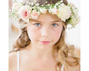 Soft pastel roses and flowering fillers were combined to create this cute flower girl garland. Image by Karen Buckle Photography.
