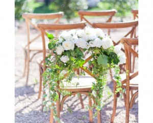 Floral chair swag featuring roses and trailing foliages. Image by Karen Buckle Photography.