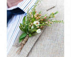 Sweet buttonhole of flowering fillers. Image by Karen Buckle Photography.