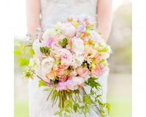 Hand held posy design of David Austin roses, cottage roses, hyacinth, snap dragons, stock, lisianthus, clethra, flowering fillers. Image by Karen Buckle Photography