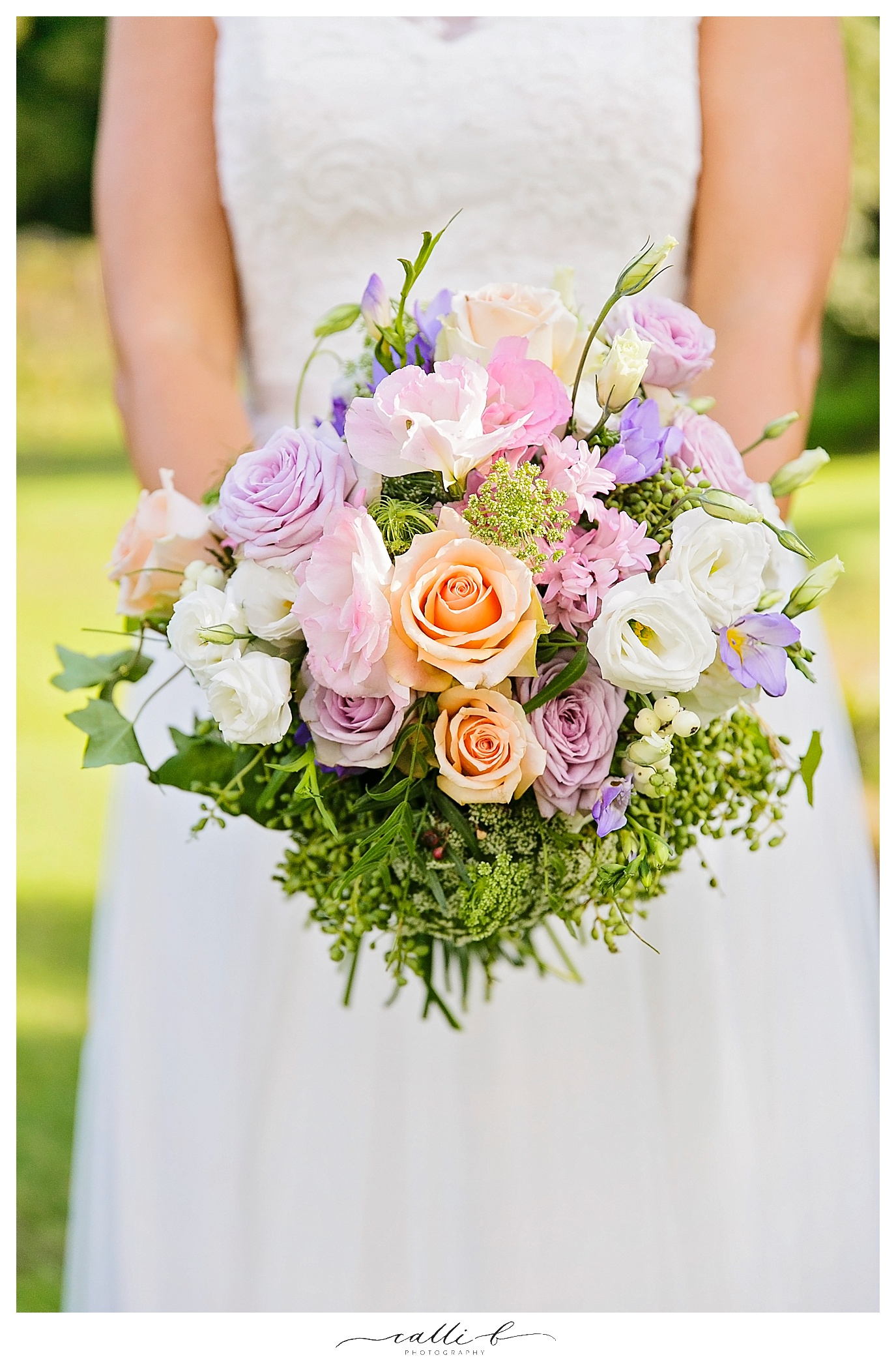 Pastel wedding bouquet featuring roses and lisianthus