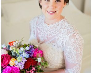 Bright whimsical bouquet featuring roses, dahlias and sea holly