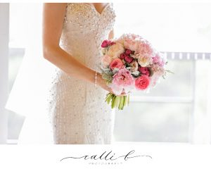 Pink wedding bouquet featuring peonies
