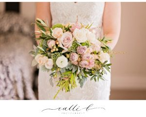 Gardenesque pastel wedding bouquet featuring roses
