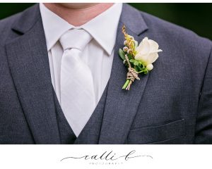 Rose buttonhole with flowering filler