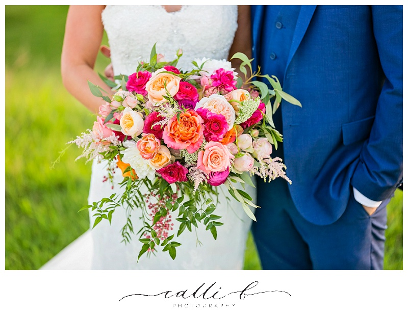 Bright whimsical wedding bouquet featuring ranunculus