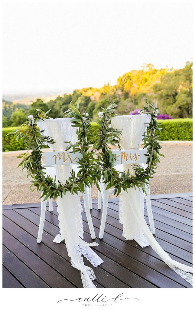 Bride and groom greenery chair garlands