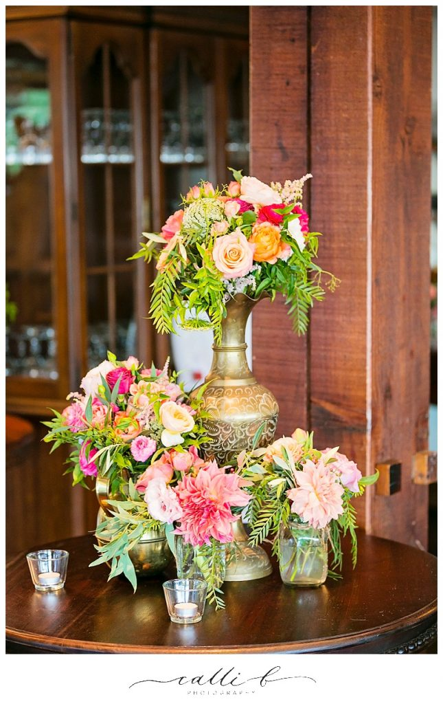 Brass reception vases with bright whimsical flowers
