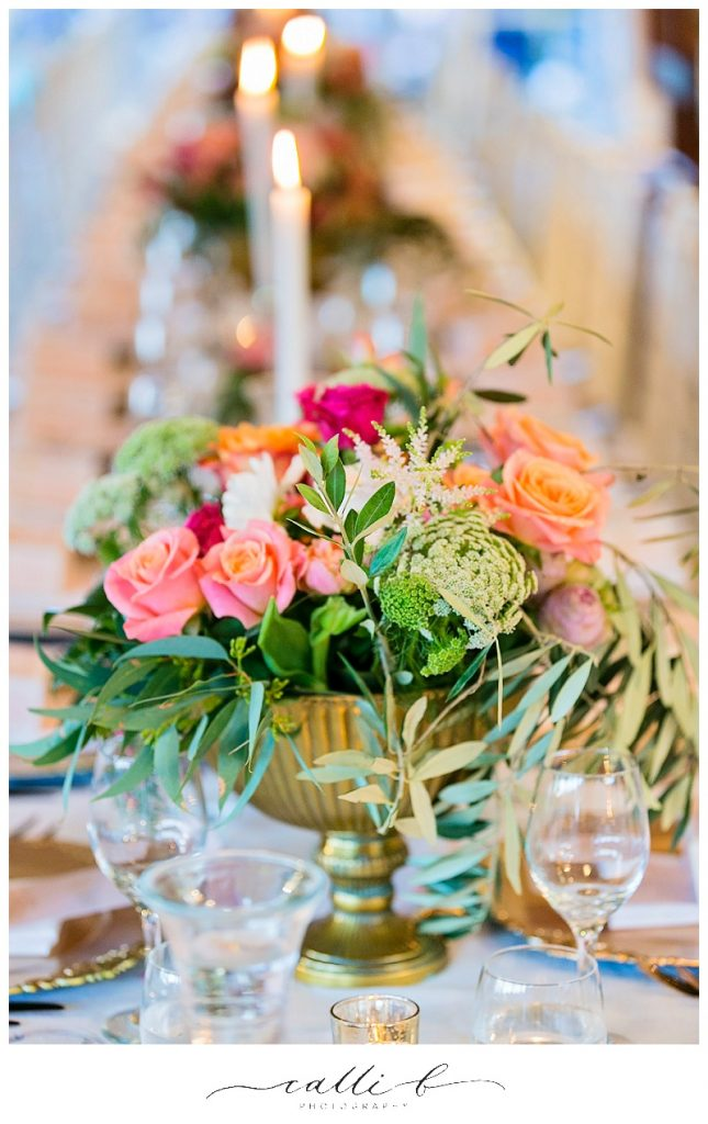 Gold reception vases with bright whimsical flowers