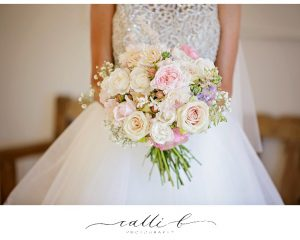 pretty pastel wedding bouquet featuring dahlias