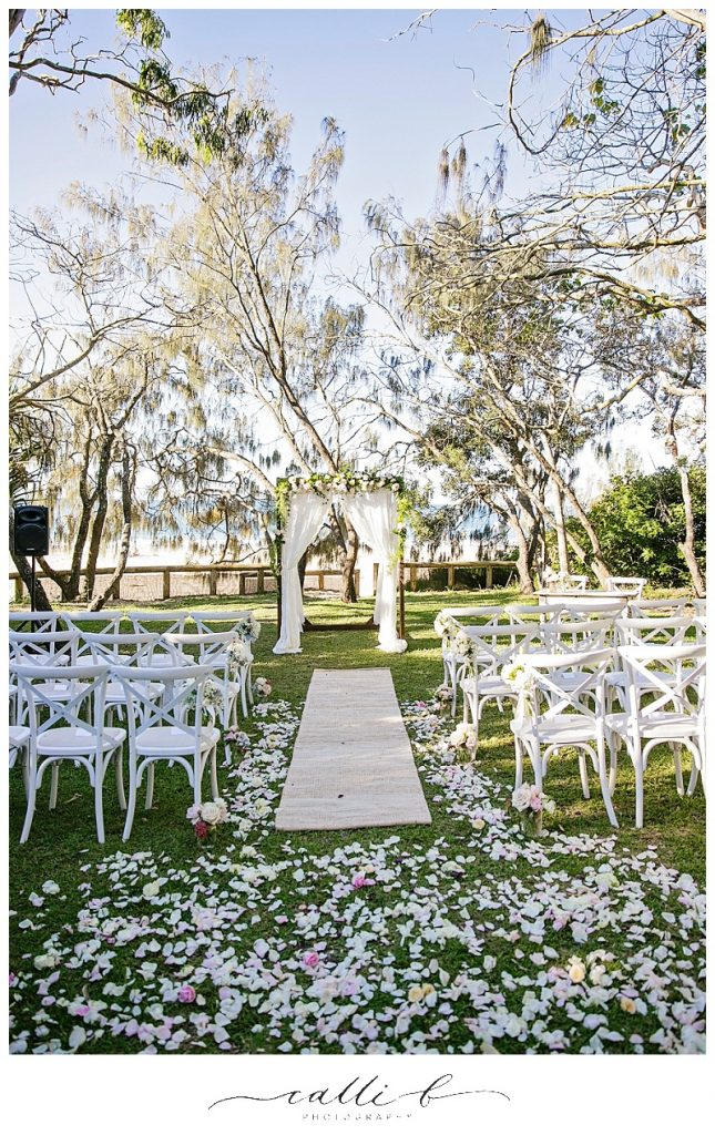Wedding ceremony rose petals and canopy flowers