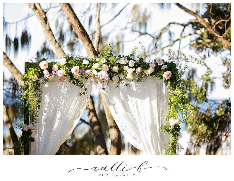 Wedding canopy flowers including roses