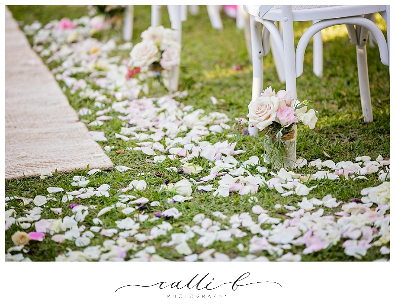 Wedding ceremony rose petals and jar flowers