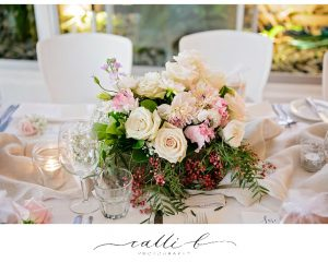 Reception timber box featuring roses and peppercorn berry