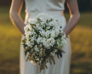 White wedding bouquet feauturing hyacinth and ranunculus