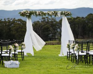 Ceremony canopy flowers featuring roses