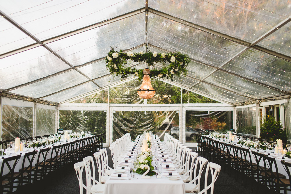 Marquee wedding flowers including garlands