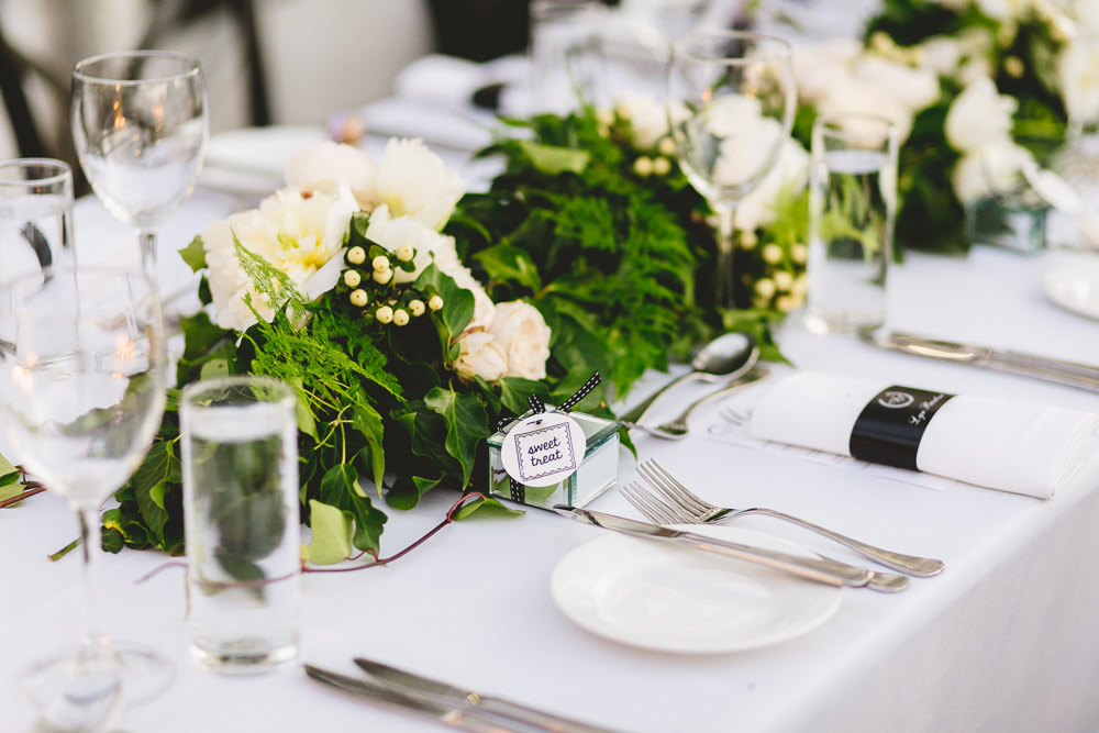 Reception table garlands featuring David Austin roses