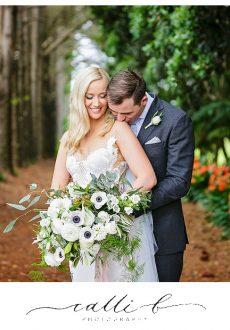 Gardenesque white wedding bouquet featuring anemones and bridal fern