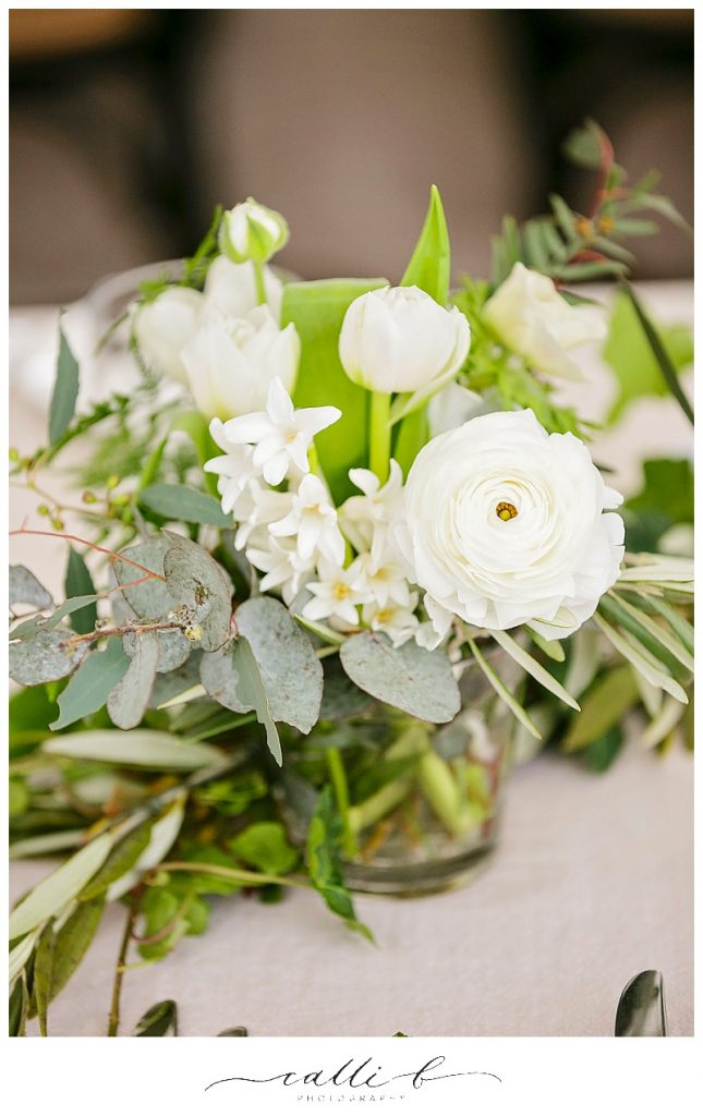 Glass reception vases featuring ranunculus and hyacinth