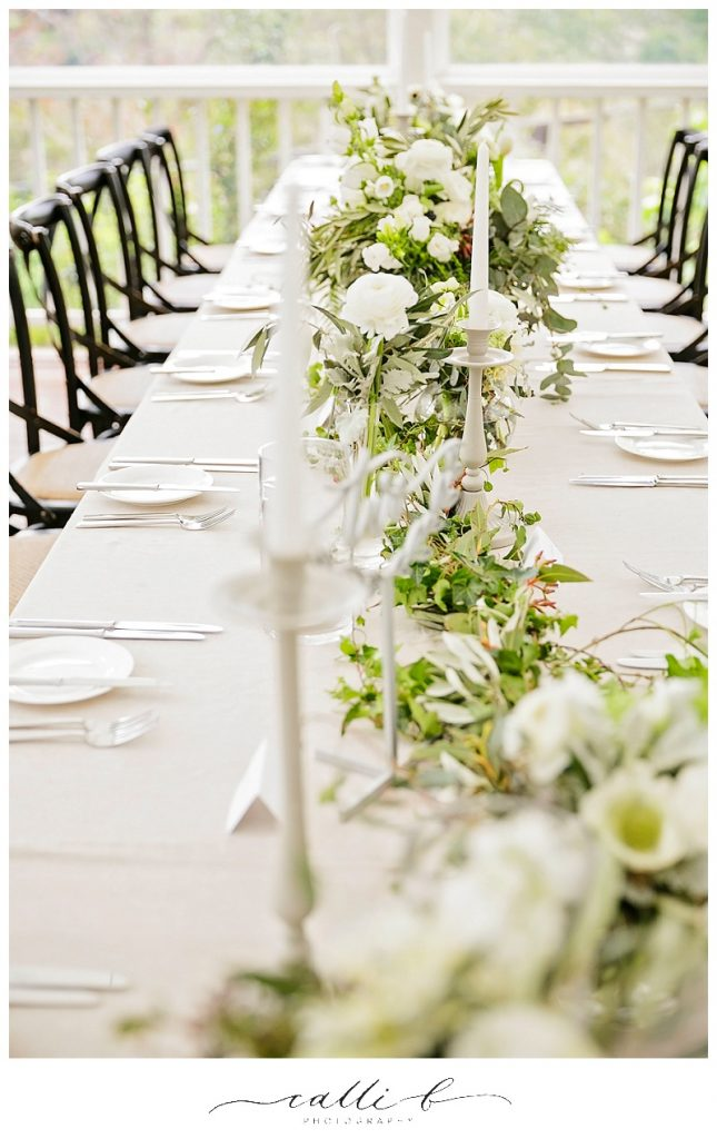 Glass reception vases featuring ranunculus and anemones