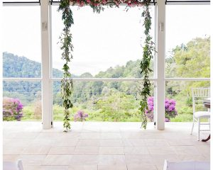 Ceremony hanging structure featuring ranunculus and jasmine