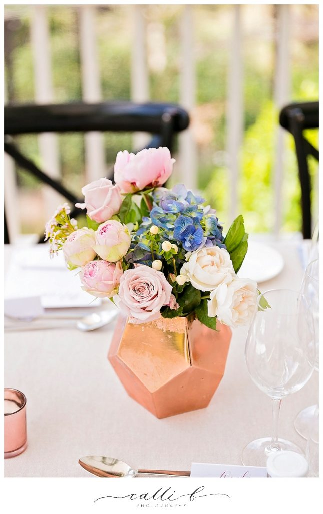 Geometric reception vases featuring David Austin roses