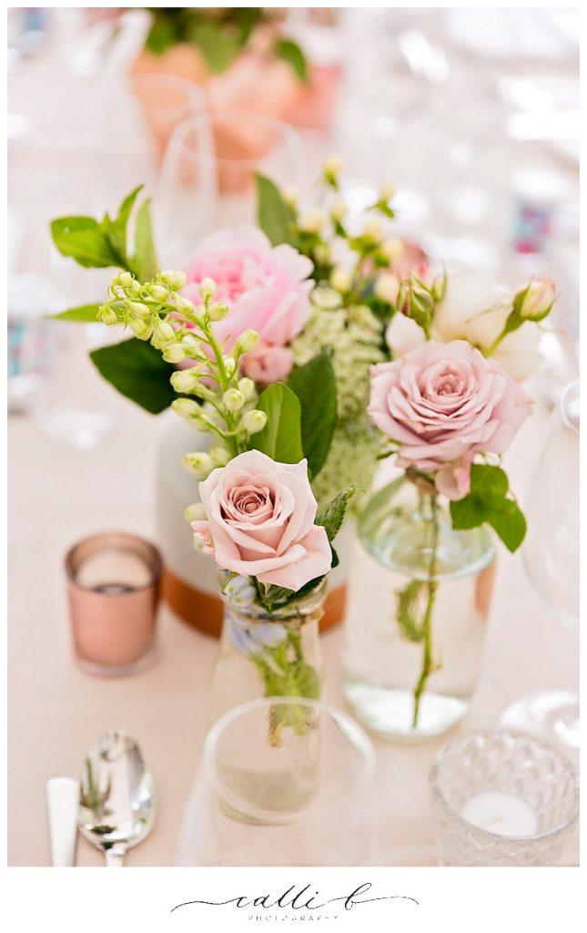 Reception bottles featuring roses and delphinium
