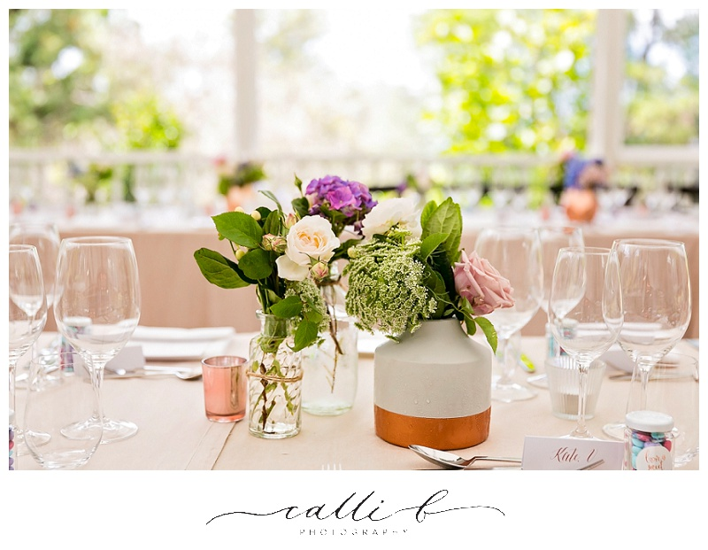 Reception vases featuring Queen Ann's lace and roses