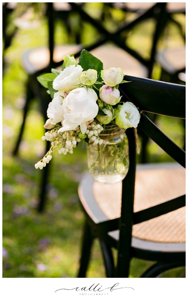 Ceremony chair jars featuring David Austin roses