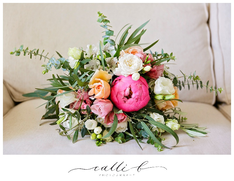 Bright rustic wedding bouquet featuring peonies and roses