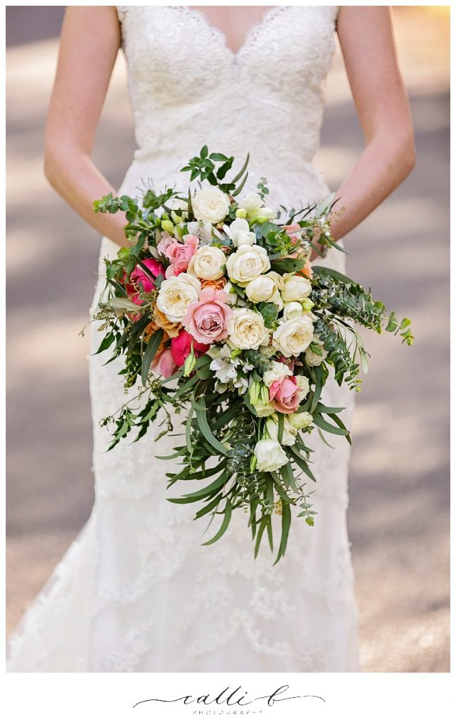 Rustic gardenesque wedding bouquet featuring roses