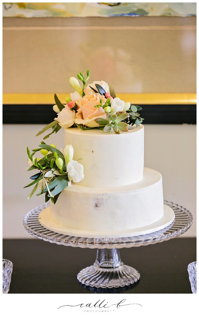 Rustic wedding cake flowers featuring succulents and roses