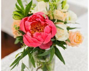 Mason Jar reception flowers featuring peonies and roses