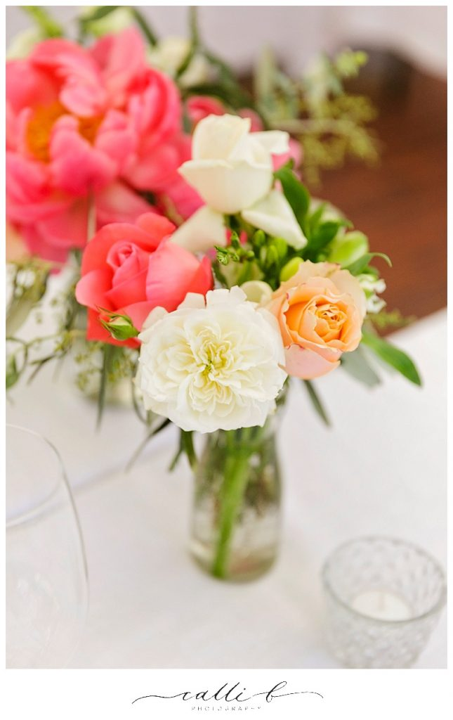 Reception flowers in jars featuring roses