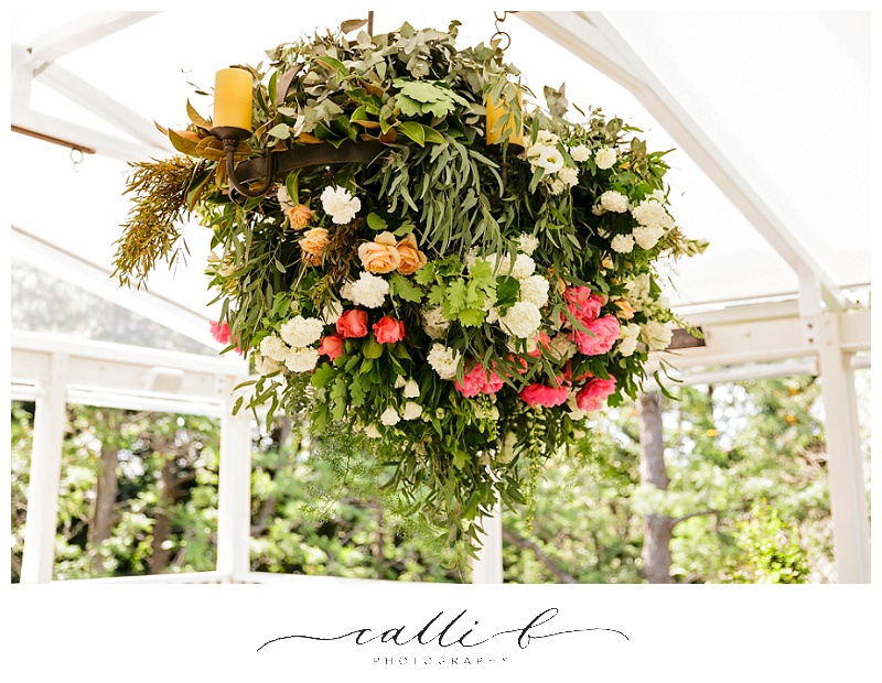 Hanging structure with rustic foliage's and peonies