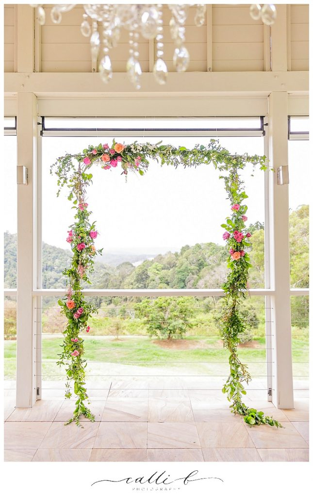 Hanging ceremony design featuring bright flowers and jasmine