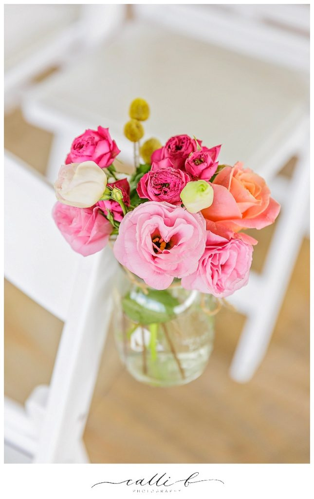 Ceremony chair jars featuring lisianthus and cluster roses