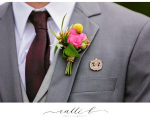 Buttonhole featuring roses and billy buttons