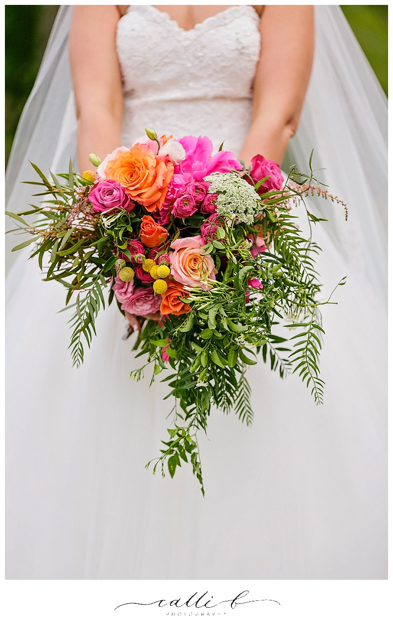 Bright gardenesque wedding bouquet featuring roses and jasmine