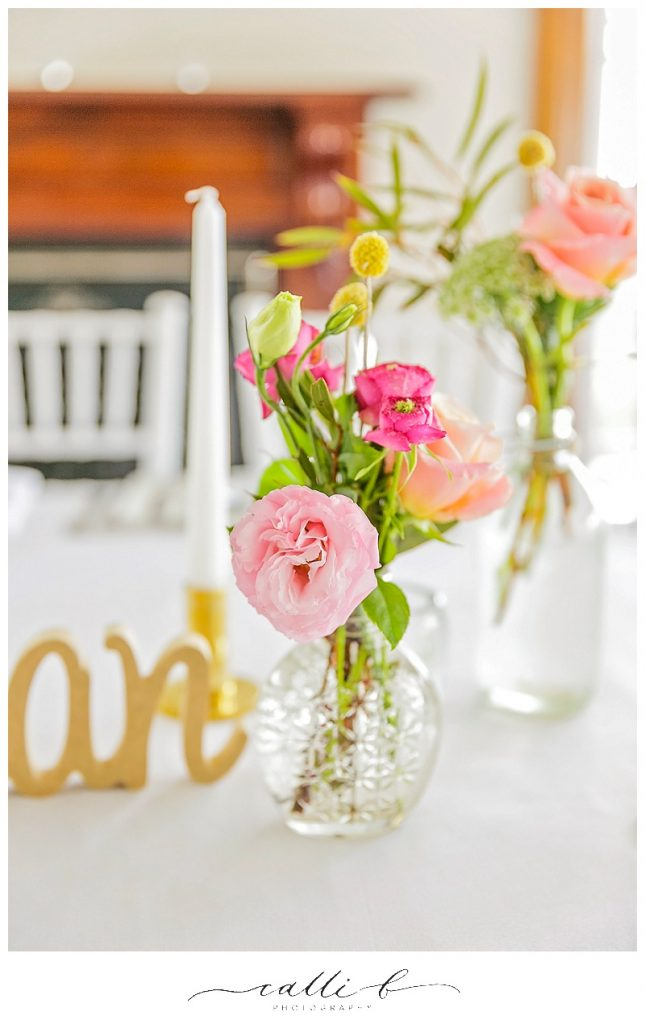 Reception flowers featuring bright blooms including roses
