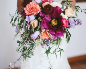 Bright rustic wedding bouquet featuring roses