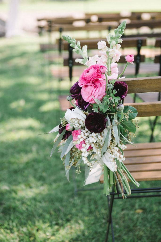 Ceremony chair posies featuring ranunculus