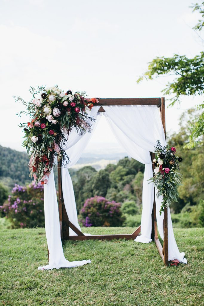 Rustic Ceremony arbour design featuring king proteas