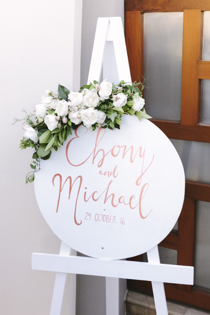 Ceremony entry sign featuring David Austin roses
