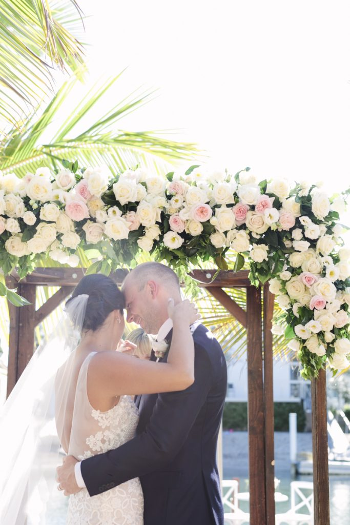 Ceremony arbour floral design featuring roses