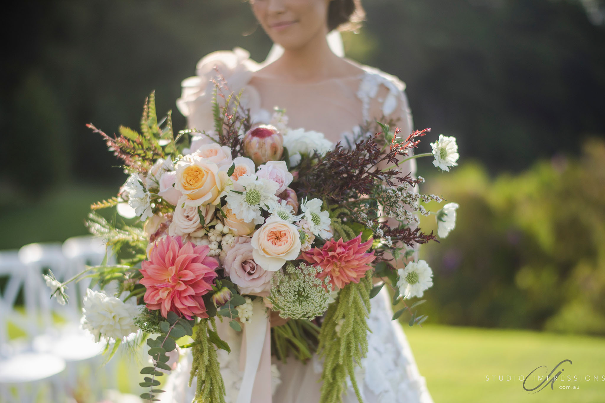 Unstructured whimsical bouquet featuring dahlias and roses