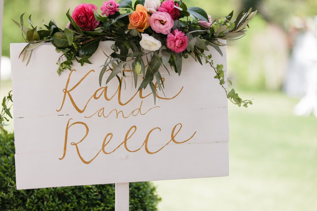 Whimsical entry sign flowers featuring roses